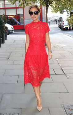 Red hot: Myleene Klass, 38, matched her passionate new relationship status to her ensemble as she arrived at the St John Ambulance's Everyday Heroes awards ceremony in London