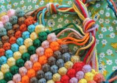 Repurpose your old T Shirts into a lovely colourful Braided Rug.  It's a super quick and easy idea you'll love. Don't miss the Hula Hoop Rug too!