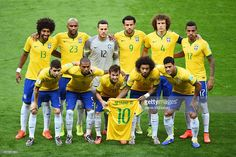 Brazil pose for a team photo holding a Neymar jersey prior to the 2014 FIFA World Cup Brazil Semi Final match between Brazil and Germany at Estadio Mineirao on July 8, 2014 in Belo Horizonte, Brazil.