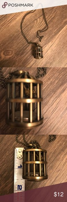 Bird in a cage watch necklace This is a very unique necklace, with a tiny bird that dangles in a cage, also has a clock in the bottom. I️ believe it works but it might need a new battery to keep up with time. Comes in a dark bronze color and the bird is a lore gold color. Please comment with any questions, thanks for looking! I️ love it when you bundle and make offers!  Jewelry Necklaces
