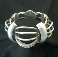 """Taxco / Mexican Vintage Jewelry  Vintage Antonio Pineda 970 silver 'Cosmos' ('Birdcage') bracelet, circa-1953 to 1978  Origin: Taxco, Mexico  Dimensions: 7"""" x 1.5"""" x .88"""" visual depth; 143.8 gm"""