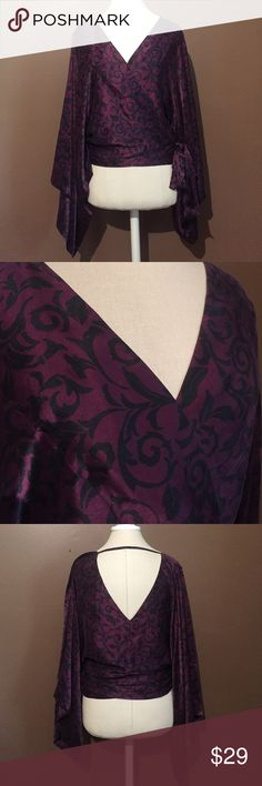 Victoria's secret very sexy silk wrap top!! This is a beautiful silk wrap top with large sleeves by Victoria's secret very sexy collection. It is a beautiful deep plum with black designs. comes in one size. Gently used and in excellent condition. See photos for details. Victorias secret Tops Blouses