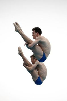 Sascha Matthias Klein and Patrick Hausding of Germany compete in the men's 10M Synchro Springboard Preliminary on day two of the 19th FINA Diving World Cup at the Oriental Sports Center in Shanghai on July 16, 2014.