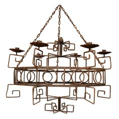 Moroccan Wrought Iron 6-Candle Chandelier. Greek Key & Circle Patterns. Circa 1940s.  (I've never seen anything like this before ... and I love it.)
