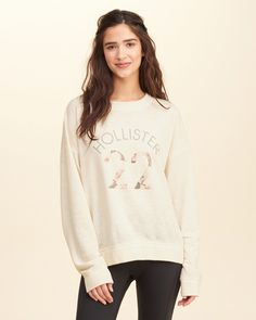 Floral Logo Graphic Sweatshirt | Hollister | A closet staple reimagined with vivid front logo graphic, Imported