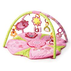 $34.99-$49.99 Baby Bright Starts Pink Pretty in Pink Supreme Play Gym - Your precious princess will flutter about on this comfy, soft Mat with lots of room and 3 ways to play: laying, tummy time, and sitting!    Plush Flower with Rattle Chimes plays 8 melodies which can be baby or parent activated    Oversized flower shaped Mirror for self-discovery    3D crinkle Flower on Mat for tummy time pla ...