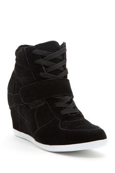 On trend: the wedge sneaker I hate this trend but I will be wearing shortly. Its what I do to be on trend!