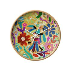 As a beautiful nod to Mexican embroidery, this vibrant wall clock really stands out among the others. Let your time pop with our Mexican folk art clock.  Find the Guadalupe Wall Clock, as seen in the Bohemian Sanctuary Collection at http://dotandbo.com/collections/bohemian-sanctuary?utm_source=pinterest&utm_medium=organic&db_sku=105456