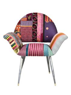 The patchwork on this chair makes it look elegant not country at all.
