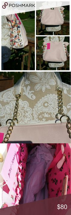 Betsy Johnson handbag Light pink Betsy Johnson handbag  has beautiful floral ribbon laced up each side of the bag. The ribbons have gold heart charms hanging on the ends. Bright gold colored chain straps & white handles. Approx 15?13. Snap closure.  Bright pink flower lining. Betsy Johnson  Bags Shoulder Bags