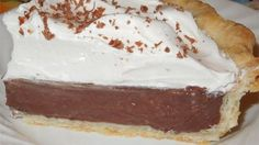 The chocolate cream filling in this rich pie is made with cocoa flavored with a bit of butter and vanilla. It 's poured into a pre-baked pastry shell and chilled before serving.