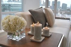 Cool end table decoration with candles and white hydrangeas