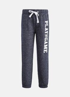 Трикотажные брюки с текстовым принтом за 899р.- от OSTIN