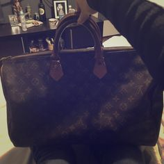 Louis Vuitton Louis Vuitton speedy 40. This bag is already priced low due to being well used. They charge 120 to change the 4 little button of the handles. Authentic Louis Vuitton Bags Clutches & Wristlets