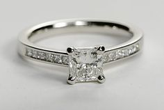 This 14kt white gold setting features 12 princess cut diamonds totaling 1/4 carats that have been delicately placed in the side of this ring.
