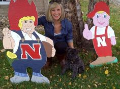 Brooke Heck, Husker Fan, with Herbie Husker and Lil' Red that Bill made.