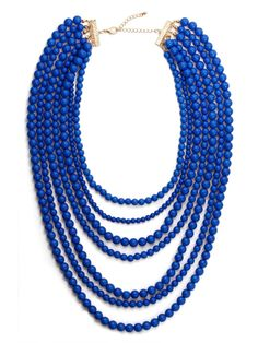 The motif of this necklace is easy enough—just simple shiny beads—but done up in a lush multi-strand look like this, the vibe is stunningly dramatic and extravagant.