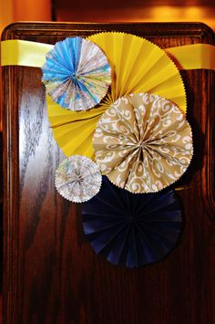 Folded paper wheels for pew end decorations.