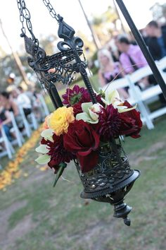 These lanterns are a great alternative to frame the bride & groom. We have them to rent!vendors: Bella  Blooms
