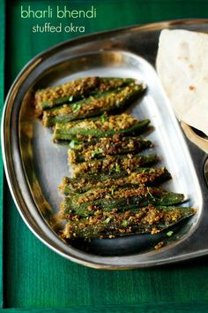 bharli bhendi recipe - maharashtrian style recipe of stuffed okra with a spiced coconut-peanut filling.