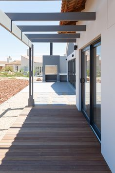 Located in a private cul de sac in Langebaan Country Estate, this home has spectacular views of the golf course, sports and other activities. Earls Court, Country Estate, West Coast, Decks, Architecture Design, Golf Courses, Stairs, Patio, Modern