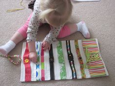 I used the idea of the buckle toy and went for an entire collection of fine motor dressing skills (button, zipper, 2 different snaps, Velcro, buckle, and lacing).  It rolls up and ties for easy travel!