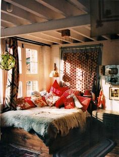 This is really a unique Bohemian bedroom; rustic & colorful.