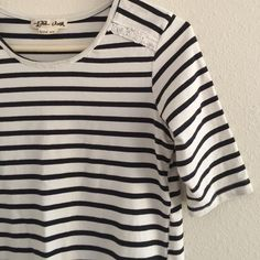 Anthropologie Striped Tee Adorable navy/cream striped tee by Lili's Closet from Anthropologie.  Elbow sleeves, lace detail, some purposely raw edges.  In excellent preowned condition, but does have a dot on it as shown in the last picture.  Not sure if this will come out in the wash, but it's hardly noticeable. Anthropologie Tops Tees - Short Sleeve