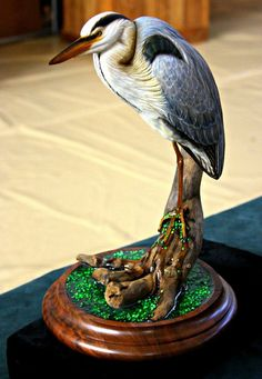 Carved from tupelo and painted with acrylics, this little heron is life-like in detail. The piece stands approximately 12 inches tall. Wood Bird, Herons, Animal Sculptures, Woodcarving, Bird Art, Ducks, Acrylics, Eagles, Paper Crafts