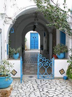 blue door and planters