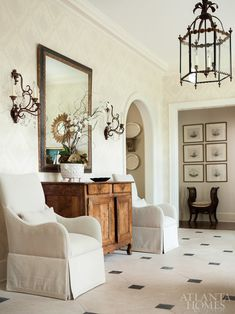 A pair of Avignon Sconces flank a mirror in the entry of this Atlanta home designed by Beth Ervin.  www.niermannweeks.com #niermannweeks