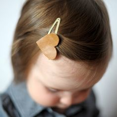 Make these super simple leather hair clips for you or the kiddos.