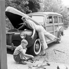 Mom fixes the family car. C.1940s found photo casual pants jeans fashion style Now this is cute! Women's fashion photo photography photo