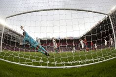 Morocco's goalkeeper Mohamed Amsif makes a save during his team's group D men's soccer match against Spain. #08012012