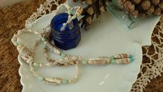 Check out this item in my Etsy shop https://www.etsy.com/listing/187978622/vintage-bolero-style-boho-shell-necklace