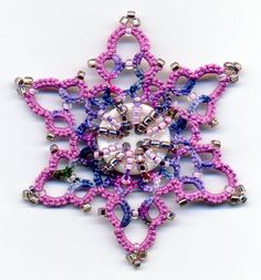 Tatting and not a lot else!: More snowflakes