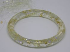Resin bangle with angelina fibre and gold leaf, jewelry, gold angelina bracelet, modern jewelry, statement bangle, sparkly, magical, by artyResin on Etsy