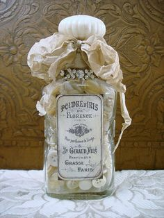 .gorgeous...stuff a lovely bottle with buttons, tie off the top with great fabric and add bling