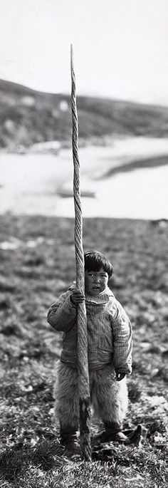 Inuit boy with narwhale tusk, early 20th century