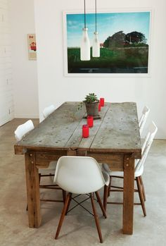 One of our favorite combinations:  Eames chairs and rustic table