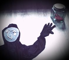 """Creepy Les"" series. (December 2016). Body suit, mixed media, glass jar, cardboard."