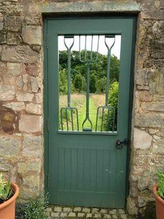 clever gateway doorway to a garden made from garden fork