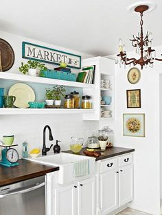 Vintage Cottage Cottage style has many decorative faces that make each home unique. Incorporating vintage treasures is a popular look that creates a personal story. A farmhouse sink and rubbed-bronze fixtures, accented with an old chandelier and throwback pottery pieces, mix comfortably in this cottage kitchen with stainless-steel appliances and other modern amenities.