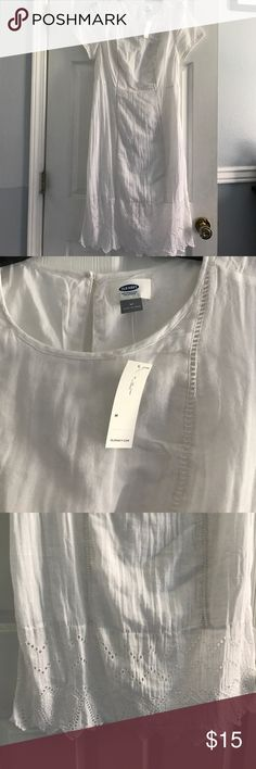 Old Navy white cotton eyelet dress New with tags. Has a lining. Old Navy Dresses Midi