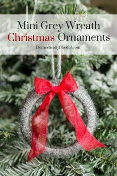 Mini wreath Christmas ornaments made with mason jar rings and yarn.