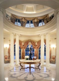 Draperies in this huge rotunda, add much-needed color and warmth to the white space.
