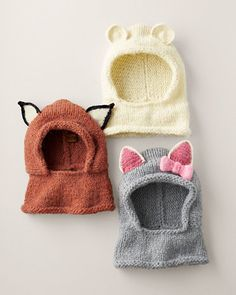 One part fuzzy friend, one part cozy accessory — this whimsical hand-knit hood is like a scarf and hat all in one, in fox, kitty or polar bear. Bursting with so much dress-up appeal, kids may even decide to wear it inside the house.