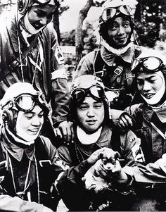 """This 1945 file picture shows kamikaze pilots posing with a puppy before their suicide attack mission, in Chiran, Kagoshima prefecture. Photo: AFP. """""""