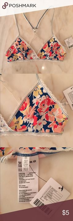 """Urban Outfitters floral bra Urban Outfitters floral bra.  No padding.  No clasp for closure;  just stretch.  Straps cannot be adjusted.  Band size approx.  22"""" around.  Never worn.  Brand new with tag still attached. Urban Outfitters Intimates & Sleepwear Bras"""
