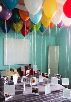 Photos on balloon strings. I think we should this! Only will add the photos higher...